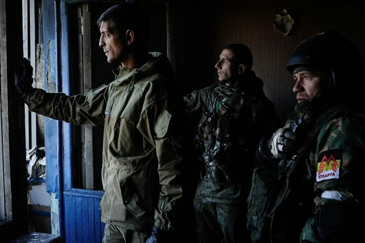 Donetsk, Ukraine. October 4th, 2014. A pro-Russian commander using the name of ''Givi'' (right) and his unit, direct artillery fire on the airport in Donetsk from a high-rise building half a kilometer away. For more than a week, Pro-Russian fighters have been attacking Ukrainian forces in an effort to regain the control over the Donetsk airport.