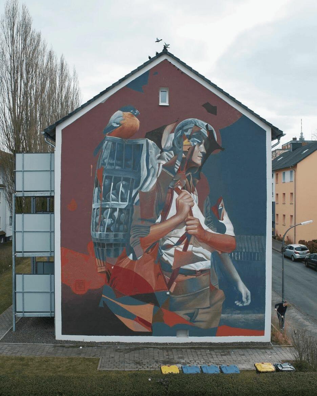 Peinture murale citadine par Telmo Miel