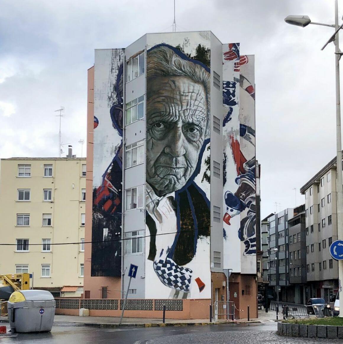 portrait énorme sur une barre d'immeuble par la street artiste Lula Goce