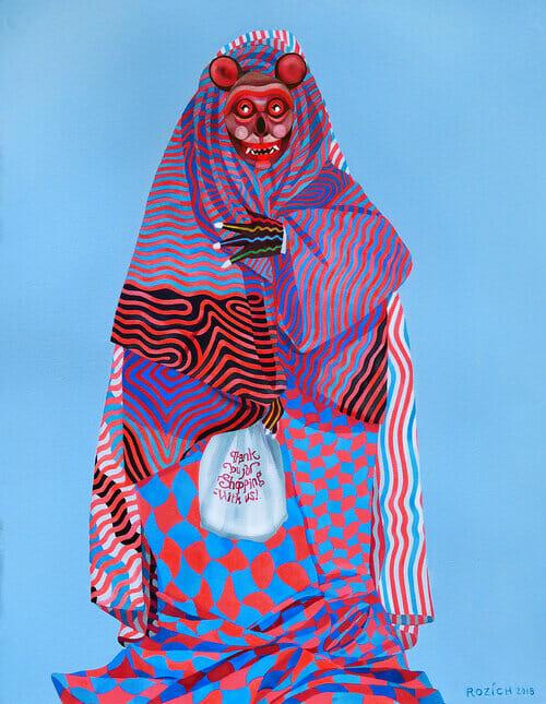 Stacey Rozich, un personnage avec une tenue traditionnelle bleu, noir et rouge.