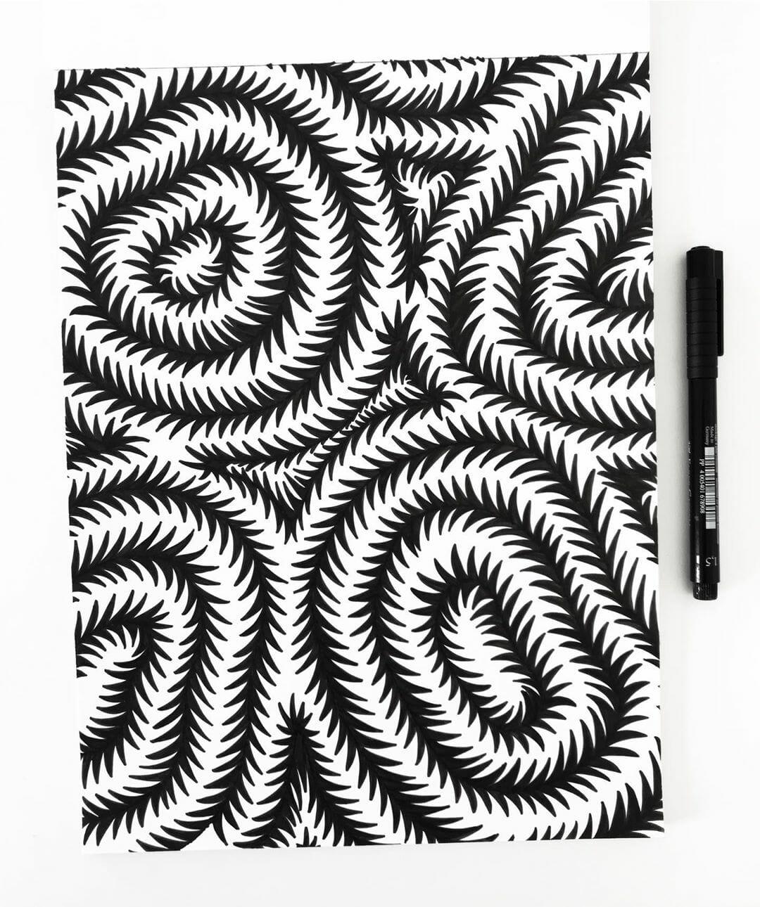 dessin hypnotique noir et blanc barbelés forme feutre