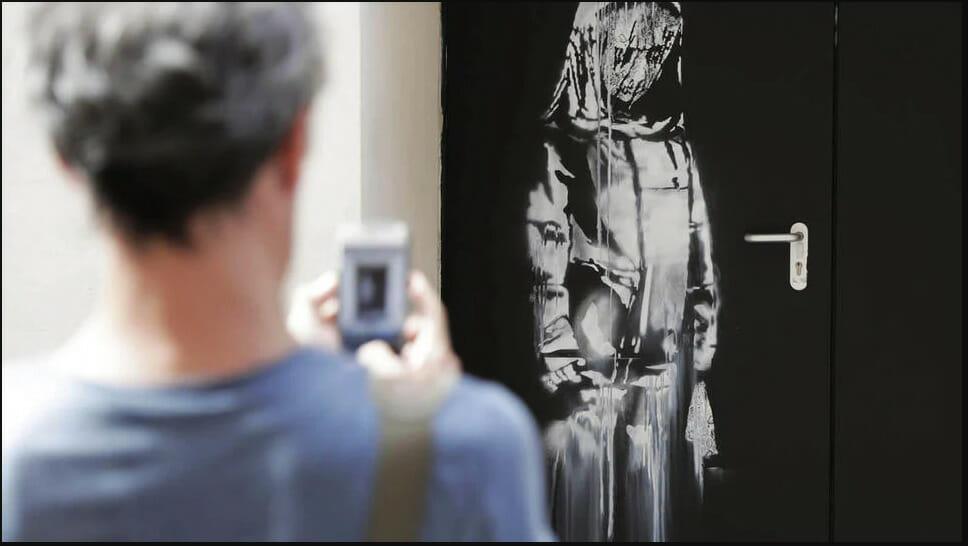 Banksy the young sad girl