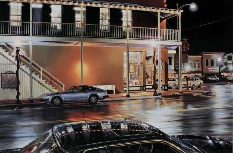 Rue typique du sud des Etats-Unis, voitures garées. Pleine nuit, mais la lumière de la ville se reflète partout.