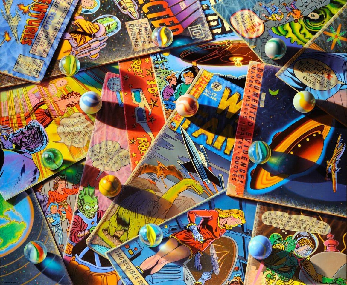 I was a space refugee - pile de comics en couleur, sur laquelle sont dispersées des billes de verre.