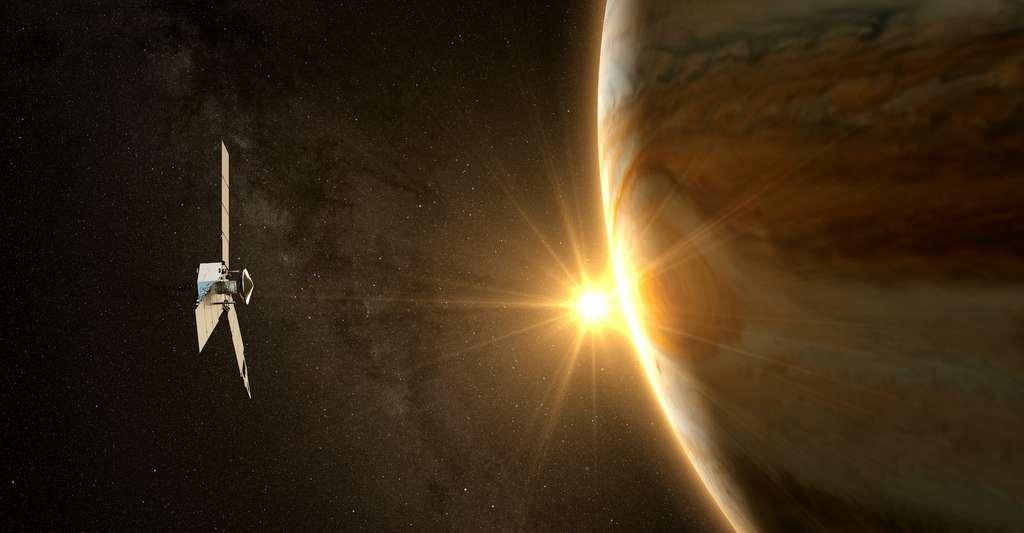 Photographie de la NASA montrant la sonde Juno et Jupiter.